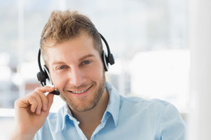 Smiling call centre agent wearing a headset